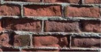 Fasadearbeid på avskallet murfasade