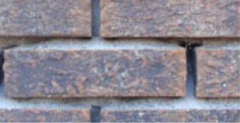 fasadearbeid på erodert murfasade